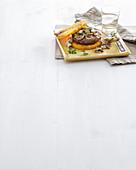 A chianina burger in polenta toast with mushrooms (Italy)