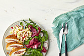 Cordon bleu with radish and kohlrabi salad