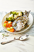 Herb bream with caper sauce and vegetables