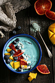 A blue majik smoothie bowl with soy yoghurt, spirulina and fruits