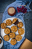 Banana nut muffins served on a large white ceramic plate photographed from top view
