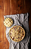 Various ways of pie decoration with lattice and leaves, Apple, strawberry and raspberry pies, uncooked