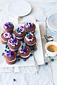 Chocolate cakes with blueberry cream and pansies
