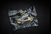 Seabream with lemon slices in a sous vide bag