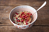 Porridge topped with pomegranate and cinnamon