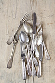 Vintage cutlery on a wooden surface