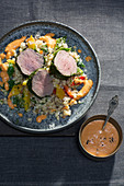 Veal medallions with a herb coating with rouille and pepper fregola