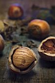 Open hazelnuts on wood (Italy, Piedmont)