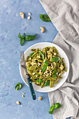 Green pasta with pesto and tofu