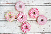 Doughnuts with pink sugar glaze and sugar decorations