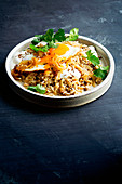 Lebanese caramelised-onion pilaf with fried eggs