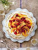 Pavlova with pistachios, nectarines, cream and raspberries for Christmas
