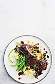 Ssticky rosemary and currant glazed lamb