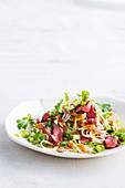 Beef, pickled cucumber and soba noodle salad