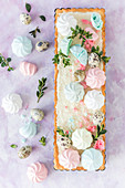 Traditional Polish Easter cake (mazurek) decorated with colorful meringues