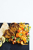 Scorched tikka lamb chops with tomato and carrot salad