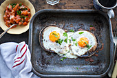 Brunch of baked eggs on portobello mushrooms
