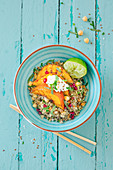 Buddha bowl with quinoa and chickpea salad, grilled pumpkin and cottage cheese