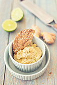Ginger hummus with lime served with crispbread
