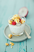 Chia pudding with coconut yoghurt with lime popcorn and dragon fruit in a glass