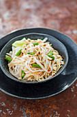 Salad with green papaya, yardlong beans and wide rice noodles (vegan)
