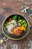 Poke bowl with celery, broccolini, green asparagus and kimchi