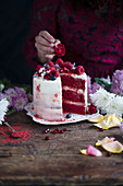 Red velvet layer cake topped with raspberries