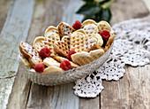 Heart shaped waffles in a glass bowl (vegan)