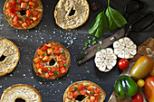 Top view of table with Italian bruschetta on frisella bread, seasoned with fresh tomatoes, garlic, olive oil, salt and basil