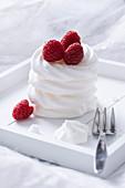 Aquafaba meringues with fresh raspberries (vegan)