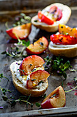 Rolls with baked plums with thyme honey and yoghurt