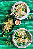 Ravioli with spinach, served with pini nuts