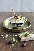An oriental style harissa and date dip with spring onions and bread