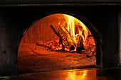 Fire burning in a pizza oven