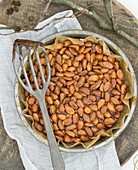 Almond brittle in a round baking dish