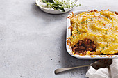 Italian sausage pie with cheesy polenta topping