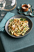 Macaroni with artichoke pesto, roasted artichokes, baby spinach and almonds