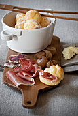 Mini cheese rolls with ham, sausages and pickled onions