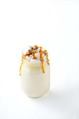White hot chocolate with caramel and roasted almonds