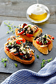 Toasts with Tomatoes and Cuttlefish Ink