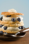Puff pastry with cream and blueberries