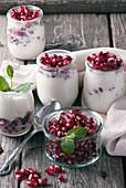 Mini yogurt with pomegranate seeds