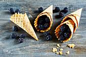 Fresh blackberries in ice cream cones