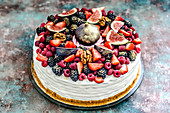 Honey cake with summer berries: ruspberry, strawberry, blackberry, blueberry, figs