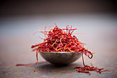 Saffron threads in a metal bowl