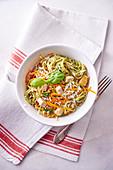 Spaghetti with pesto, tofu and carrots