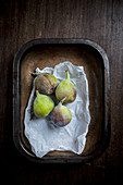 Four figs in a metal tray