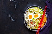 Low carb soup with zoodles, Chinese cabbage, carrots, mung beans, egg and chilli (Asia)