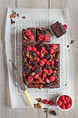 Chocolate tarybake with chocolate buttercream icing, chocolate and pecan bark and berries