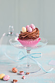 Easter chocolate cupcake on a glass stand
